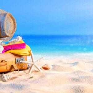 koffer packen am strand